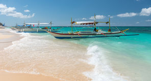 Traditional filipino asian ferry taxi tour boats on puka beach Stock Photo
