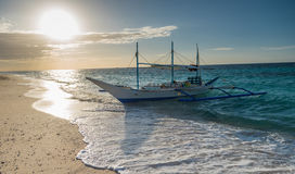 Traditional filipino asian ferry taxi tour boats on puka beach Royalty Free Stock Photos