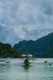 Traditional Filipino boat on Calm sea water in Stock Images