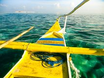 Traditional filipino fishing boat. An old Filipino fishing boat floating on the clear sea water Royalty Free Stock Photography