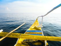 Traditional filipino fishing boat. An old Filipino fishing boat floating on the clear sea water Stock Photos