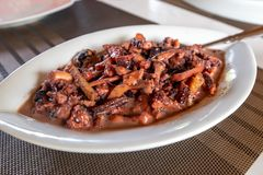Traditional Filipino Food - Pusit Adobo. Coron, Palawan, Philippines stock photo