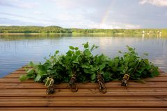 Traditional Finnish bath whisks on a jetty by the lake