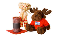 Traditional finnish straw toy, candle and reindeer. Toy isolated stock photography