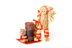 Traditional finnish straw toy, candle and tiger. Symbol of next year, isolated royalty free stock photography