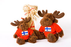 Traditional finnish straw toy and two reindeer toy. Isolated royalty free stock images