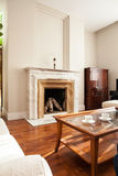 Traditional fireplace in luxury parlour Stock Photos