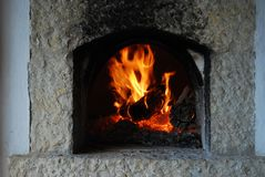 Traditional firewood oven. Burning flames in fireplace stock photo