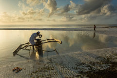 Traditional fisher boat in Zanzibar with people going to fish on Stock Image