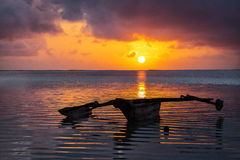 Traditional fisher boat in Zanzibar on a white beach at a beauti Royalty Free Stock Images