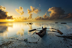 Traditional fisher boat in Zanzibar on a white beach at a beauti Royalty Free Stock Photography
