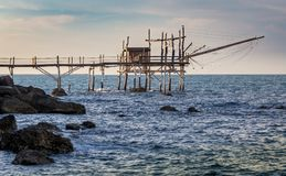 Traditional fisher hut trabocchi at sunset Stock Images