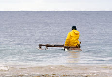 Traditional fisherman. Setting out in outrigger canoe Stock Images