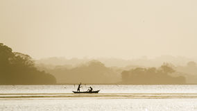 Traditional fisherman in Arugam bay lagoon, Sri Lanka Royalty Free Stock Image