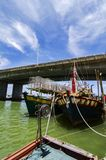 Traditional fisherman boat, anchored over blue sky background Royalty Free Stock Images