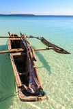 Traditional fisherman boat lying near the beach in clear water Royalty Free Stock Photos