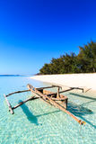 Traditional fisherman boat lying near the beach in clear water Royalty Free Stock Photography