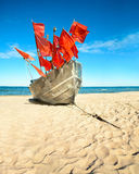 Traditional fisherman boat on a sandy shore of the Baltic Sea. Baabe willage, island Rugen, Germany Stock Photos