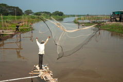 Traditional fisherman casting. Stock Images