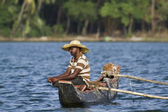 Traditional fisherman in dugout canoe in Sri Lanka Royalty Free Stock Photo