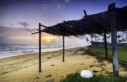 Traditional fisherman hut made from coconut leaves near the shore Royalty Free Stock Images