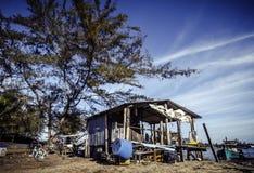 Traditional fisherman hut near the shore, blue sky and retro look Royalty Free Stock Photo