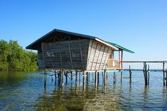 Traditional fisherman's house on stilts in the sea. Stock Photos