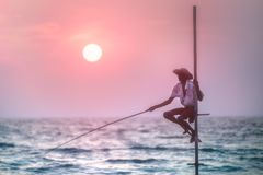 Traditional fisherman at the sunset, Sri Lanka. Silhouette of traditional fisherman who catch fish at ocean during sunset stock photo