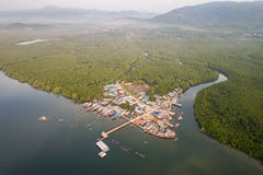 Traditional fisherman village. Top view traditional fisherman village `Ban Sam Chong Tai` with the green mangrove forest at Phang-Nga bay southern of Thailand Royalty Free Stock Images