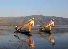Traditional fishermen at Inle lake in Myanmar. Myanmar travel attraction landmark - Traditional Burmese fishermen with fishing net at Inle lake in Myanmar famous stock image