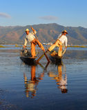 Traditional fishermen at Inle lake in Myanmar Stock Photo