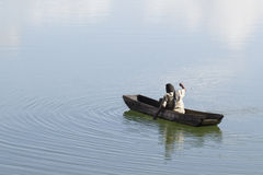 Traditional fishermen in a lake. A fisherman pulling a net Stock Images