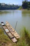 Traditional fishermen riverboats. Traditional riverboats used by fishermen docked in downtown Luang Prabang, Laos Stock Photography