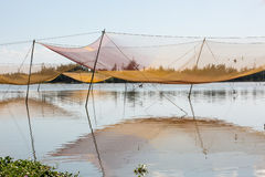 Traditional fishermen's net on river near Hoi An, Vietnam Stock Images