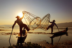 Traditional fishermen silhouette at Inle lake royalty free stock images