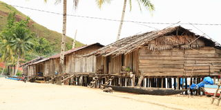 Traditional fishers houses. Traditional fishers house made from wood on pillars in Indonesian village - Papua Barat, Indonesia Stock Photo