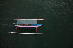 Traditional fishing boat from above in Pantai Saba beach, Bali, Indonesia Stock Photo