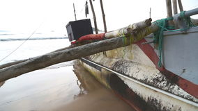 Traditional fishing boat on the beach in Weligama, Sri Lanka stock video footage