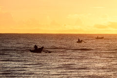 Traditional fishing boat with fisherman at sunrise Royalty Free Stock Photography