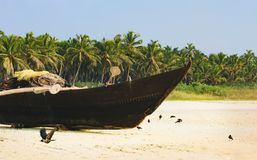 Traditional fishing boat on the Goa beach, India. Stock Photography