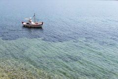 Traditional fishing boat (kaiki) on the island of Samos, Greece Stock Images