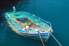 Traditional fishing boat at Lefkada island in the water Stock Photos