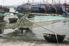 Traditional Fishing Boat with Net and Woven Bamboo Basket Boat At The Fishing Village in Da Nang, Sou Royalty Free Stock Photo