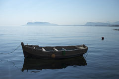 Traditional fishing boat in the port of Palermo. A traditional fishing boat at the dock in the port of Palermo in the morning sun royalty free stock photo