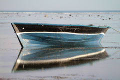 Traditional fishing boat with reflection on the water Stock Photo