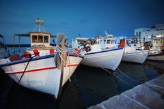 Traditional fishing boats in the charming port of Naoussa, Cyclades , Greece. Traditional fishing boats in the charming port of Naoussa, Cyclades island, Greece royalty free stock image