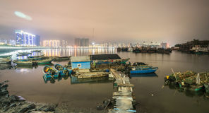 Traditional fishing boats and city lights Stock Image