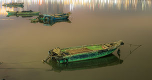 Traditional fishing boats and city lights Royalty Free Stock Image