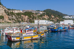 Traditional fishing boats at the fishing harbour of Sesimbra. Sesimbra, Portugal. February 22, 2015: Traditional fishing boats at the fishing harbour of Royalty Free Stock Images