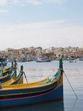 Traditional fishing boats and harbour, malta. Colourful fishing boats in Marsaxlokk, Malta Royalty Free Stock Photography